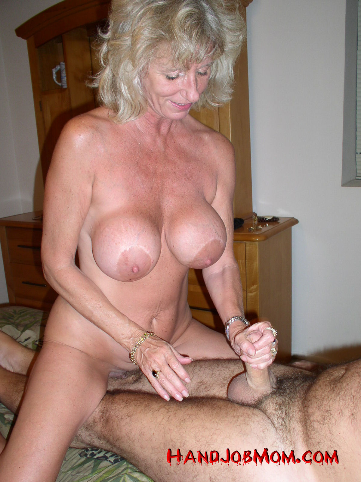 image Mom gives handjob to his step son